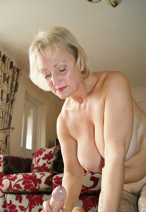 Giving granny hand job
