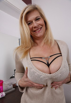 image Busty mature mom seduces lucky young boy