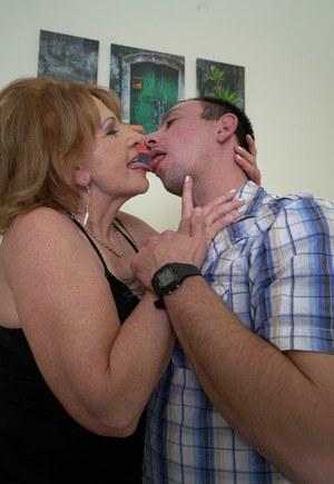 Granny kissing boy